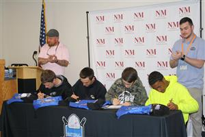 Carpentry students signing letters of intent for employment, post-secondary, and the military.